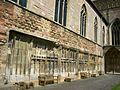 Tewkesbury Abbey, remains of cloister looking east.jpg
