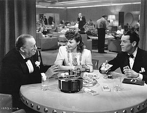 Screwball comedy film - In The Lady Eve, Jean (center, played by Barbara Stanwyck) passes herself off as an upper-class woman.