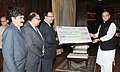 The CEO&MD, Industrial Finance Corporation of India (IFCI), Shri Malay Mukherjee presenting the interim dividend cheque to the Union Minister for Finance, Corporate Affairs and Information & Broadcasting, Shri Arun Jaitley.jpg