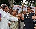 The Governor of Uttarakhand, Smt. Margaret Alva and the Chief Minister of Uttarakhand, Shri Ramesh Pokhriyal holding the Queen's Baton 2010 Delhi on it's arrival at Dehradun, in Uttarakhand on July 06, 2010.jpg