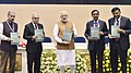 The Prime Minister, Shri Narendra Modi releasing the report 'Transforming India's Mobility A Perspective' at the inauguration of the Global Mobility Summit, organised by NITI Aayog, in New Delhi.JPG