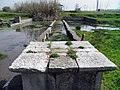 The elongated pathway flanked by low walls symbolizing the Nile, the sacred river of Egypt, Sanctuary of Isis, Ancient Dion (6934112594).jpg