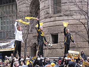 Super Bowl XLIII - Three Steelers fans waving Terrible Towels at a Pittsburgh rally prior to the game.