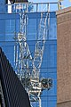 Tower crane reflection, Little Britain, City of London England.jpg