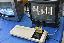 Turbo Chameleon 64 cartridge in use on C64 Games System (RetroMadrid 2017).jpg