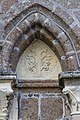Tympan sur la façade de la collégiale Saint-Évroult, Mortain, France-3.jpg