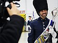 U.S. Air Force Chief Master Sgt. Edward Teleky, right, a drum major with the U.S. Air Force Band, gives an interview 130111-F-HB697-516.jpg