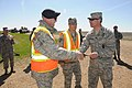 U.S. Air Force Col. Ron Vercher, right foreground, the commander of the 91st Missile Wing, congratulates Tech. Sgts. Christopher Jones and Chadrick Dispence on their selection for promotion to master sergeant 130522-Z-WA217-544.jpg