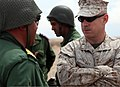 U.S. Marine Corps Capt. Robert May, the commanding officer of Alpha Company, Battalion Landing Team 1st Battalion, 2nd Marine Regiment, 24th Marine Expeditionary Unit, speaks with a member of the Royal Moroccan 120410-M-HF911-030.jpg