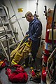 U.S. Naval Academy Midshipman Wesley Frazier dons firefighting equipment aboard the guided missile destroyer USS Truxtun (DDG 103) in the Persian Gulf June 26, 2014 140626-N-EI510-037.jpg