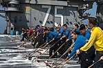 U.S. Sailors and Marines scrub the flight deck of the aircraft carrier USS Harry S. Truman (CVN 75) March 9, 2014, in the Gulf of Oman 140309-N-VE959-078.jpg