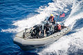 U.S. Sailors assigned to the guided missile destroyer USS Stockdale (DDG 106) maneuver a rigid-hull inflatable boat alongside the ship during small-boat operations in the U.S. 5th Fleet area of responsibility 130522-N-HN991-036.jpg