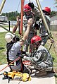 U.S. Soldiers, assigned to the Alabama Army National Guard, rescue a role player from a sewer during a training exercise at Pelham Range in Alexandria, Ala., July 25, 2012 120725-A-MU742-007.jpg