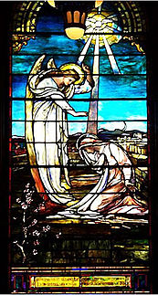 The Virgin Mary kneels to receive the God's message from an angel. The dove of the Holy Spirit descends in rays of light.