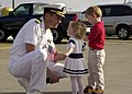 US Navy 020720-N-5292M-008 Executive Officer of USS Abraham Lincoln (CVN 72), says farewell to his children before departing.jpg