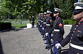US Navy 030525-N-7438S-007 The U.S. Marine firing detail stands at parade rest during a Memorial Day ceremony.jpg