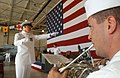 US Navy 030904-N-4385W-001 Navy Band Northwest member Musician 3rd Class David Bayne, from St. Louis, Mo., Chief Musician Brian Freeman, from Erie, Penn. during a warm up in preparation for a change of command ceremony.jpg