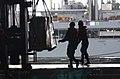 US Navy 040411-N-9851B-006 Sailors aboard the nuclear powered aircraft carrier USS Harry S. Truman (CVN 75) retrieve cargo transferred from the Military Sealift Command (MSC) underway replenishment oiler USNS Laramie (T-AO 203).jpg