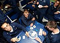US Navy 041224-N-4757S-194 Sailors enjoy playing a game of cards during a Christmas Eve ice cream social.jpg