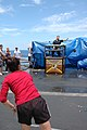 US Navy 050312-N-9703H-002 On the flight deck aboard USS Carl Vinson (CVN 70), Boatswain's Mate Seaman Jessica Brown from deck department, tries to dunk Reactor Department's Leading Chief Petty Officer Master Chief Electr.jpg
