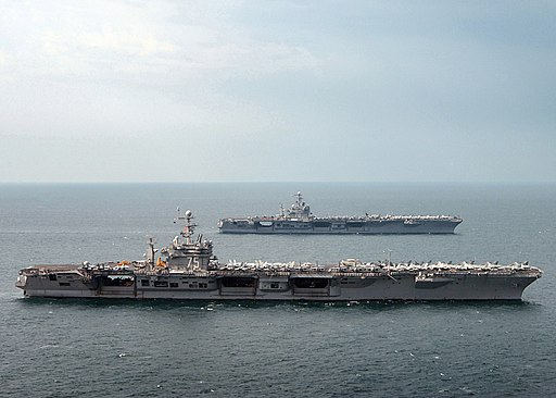 US Navy 050319-N-4308O-149 The Nimitz-class aircraft carrier USS Harry S. Truman (CVN 75), foreground, is relieved by the Nimitz-class Aircraft Carrier USS Carl Vinson (CVN 70) in the Persian Gulf