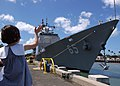 US Navy 050725-N-3019M-003 A family member waves goodbye as the guided missile cruiser USS Chosin (CG 65) departs Naval Station Pearl Harbor.jpg