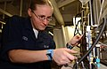 US Navy 051113-N-0685C-003 Aviation Electronics Technician Airman Tiffany Yates of Houston, Texas, troubleshoots a signal analyzer aboard the Nimitz-class aircraft carrier USS Theodore Roosevelt (CVN 71).jpg