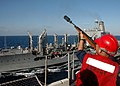 US Navy 060901-N-2651J-091 Gunner's Mate 3rd Class Juan Gonzales fires a line across to the Military Sealift Command (MSC) fleet replenishment oiler USNS Kanawha (T-AO 196).jpg