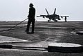US Navy 070406-N-2659P-154 A Sailor uses a pushback bar to assist with retracting the arresting gear wire after an F-A-18C Hornet, from the Blue Diamonds of Strike Fighter Squadron (VFA) 146, lands aboard Nimitz-class aircraft.jpg