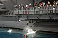 US Navy 070522-N-0890S-064 Sailors and Marines jump from elevator 3 during swim call aboard the nuclear-powered aircraft carrier USS Nimitz (CVN 68).jpg