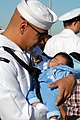 US Navy 071008-N-9909C-009 Hospital Corpsman 3rd Class Ruben Cervantez meets his week-old son for the first time as guided-missile destroyer USS Milius (DDG 69) returns to her homeport.jpg