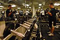US Navy 071204-N-4133B-079 Lt. Joel Rolley lifts weights in the main gym aboard the Nimitz-class nuclear-powered aircraft carrier USS Ronald Reagan (CVN 76) as part of maintain a healthy lifestyle month.jpg
