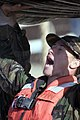 US Navy 071217-N-3398B-101 Olympic hopeful Stacy Dragila struggles to lift an Inflatable Boat Small (IBS) above her head during an IBS training evolution.jpg