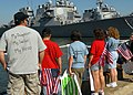 US Navy 080718-N-4879G-038 Friends and family wait on the pier at Naval Station Norfolk, Va., for the return of the guided-missile destroyer USS Cole (DDG 67).jpg