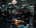 US Navy 080802-N-1786N-058 Hospital Corpsman 3rd Class Angela Martinez and Hospital Corpsman 3rd Class Michael Curcio respond to casualties during a mass casualty drill.jpg