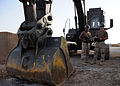 US Navy 081006-N-1120L-016 Equipment Operator 2nd Class Gerald Flint and Equipment Operator Constructionman Apprentice Toriano Frick conduct equipment checks on an excavator.jpg