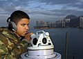 US Navy 081122-N-9520G-004 Quartermaster Seaman Elvis Gomez, from Manhattan, N.Y., and assigned to the forward-deployed amphibious assault ship USS Essex (LHD 2), makes reports on surface contacts as Essex enters Hong Kong harb.jpg