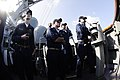 US Navy 090117-N-7918H-013 Officers and enlisted personnel stand watch aboard the guided-missile destroyer USS Mahan (DDG 72) during a vertical replenishment with the Military Sealift Command fleet replenishment oiler USNS Tipp.jpg