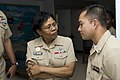 US Navy 090429-0184L-N-008 CORPUS CHRISTI, Tx. (April 29, 2009) Bureau of Medicine and Surgery Force Master Chief Laura Martinez listens as Hospital Corpsman 2nd Class Sarom Meas describes some of his career successes.jpg