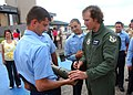 US Navy 090514-N-7427G-001 Drew Brees, quarterback of the New Orleans Saints, autographs an inert bomblet for Aviation Ordnanceman 2nd Class Andrew Burk.jpg