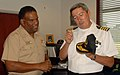 US Navy 090812-N-2821G-007 cuador Navy Capt. Ramon Ruben Orellana Mariscal, right, presents a gift to Rear Adm. Victor G. Guillory.jpg