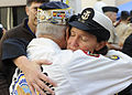 US Navy 091204-N-7032B-182 Command Master Chief Kathleen A. Hansen, assigned to Naval Medical Center San Diego (NMCSD), hugs retired Chief Electricians Mate Stuart Hedley, a Pearl Harbor survivor.jpg