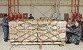 US Navy 100125-N-9402B-002 Sailors strap down pallets of humanitarian supplies.jpg