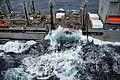 US Navy 100209-N-4774B-259 Fuel lines from the Military Sealift Command fleet replenishment oiler USNS Leroy Grumman (T-AO 195) are sent across cables to the Nimitz-class aircraft carrier USS Carl Vinson (CVN 70).jpg
