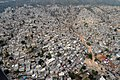 US Navy 100316-N-5961C-021 An aerial view of Port-au-Prince, Haiti shows the proximity of homes, many damaged in a major earthquake and subsequent aftershocks.jpg