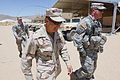 US Navy 100721-N-8863V-460 Capt. Jay Kadowaki walks with Maj. Brian Murphy, the brigade command intelligence trainer, during a visit to inspect the counter-improvised explosive device research.jpg
