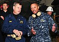 US Navy 110327-N-5538K-083 Rear Adm. Jeffery S. Jones, left, discusses humanitarian assistance operations with Capt. Bradley Lee, commander of Amph.jpg