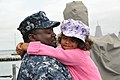 US Navy 110511-N-QY430-007 Fire Controlman 1st Class Rodney Thomas holds his daughter one last time aboard the guided-missile cruiser USS Anzio (CG.jpg