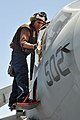 US Navy 110520-N-1004S-575 Aviation Machinist Mate Airman Scott Hallock cleans the cockpit shield of an EA-6B Prowler aboard the aircraft carrier R.jpg