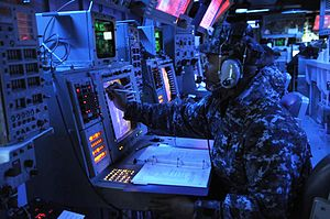 US Navy 120214-N-IO627-038 Operations Specialist 1st Class Lionel Mahoney records enemy locations during a fleet synthetic training scenario.jpg